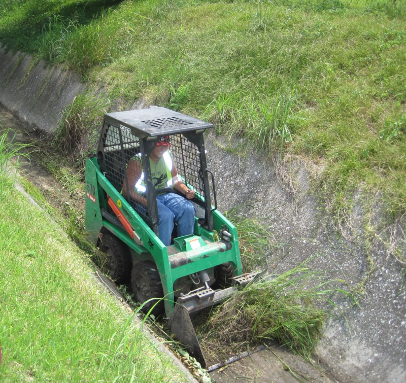 Worker clearing a ditch
