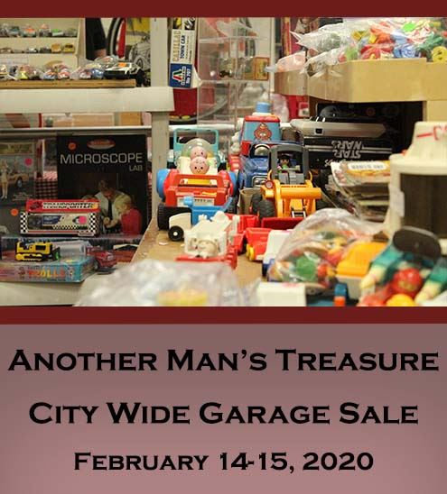 "Decorative - photo of table with used toys. Text reads ""Another Man's Treasure City Wide Garag"