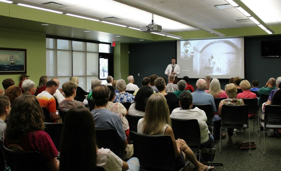Brady Hutchison, Professor of History at Alvin Community College, presenting to a full room